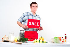 Portrait of a young man, hold sale mark Royalty Free Stock Photography