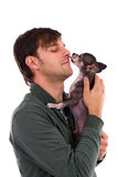 Portrait of a young man holding a cute chihuahua dog. On white Royalty Free Stock Image