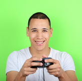 Portrait of young man holding game controller and playing games Royalty Free Stock Photography
