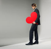 Portrait of the young man holding heart Royalty Free Stock Images