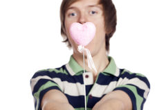 Portrait of a young man holding heart shape toy Royalty Free Stock Image
