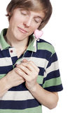 Portrait of a young man holding heart shape toy Stock Image