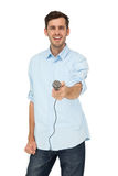 Portrait of a young man holding out microphone Royalty Free Stock Photo
