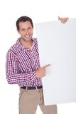 Portrait Of Young Man Holding Placard Stock Photos