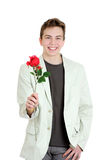 Portrait of young man holding the rose over the white background Royalty Free Stock Images