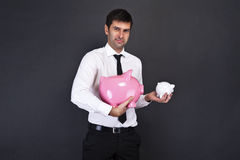Portrait of young man holding a two piggy bank Stock Image