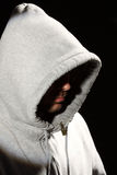 Man in a hood. Portrait of a young man in a hood Stock Photography