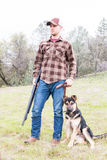 Portrait of Young Man Hunting With Dog Royalty Free Stock Images