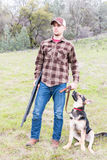 Portrait of Young Man Hunting With Dog Stock Photo
