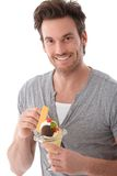 Portrait of young man with ice cream smiling Royalty Free Stock Images
