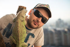Portrait of the young man with the iguana Royalty Free Stock Images