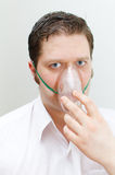 Portrait of young man with inhalator Royalty Free Stock Image