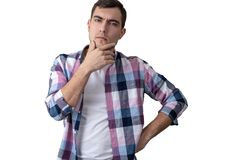 Portrait of a young man isolate on white, pensive look royalty free stock photography