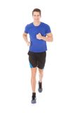Portrait of young man jogging Stock Photo