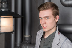 Portrait of a young man with a lantern Stock Image
