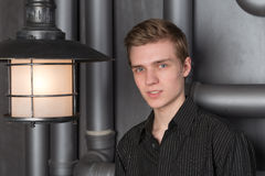 Portrait of a young man with a lantern Stock Photo