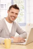 Portrait of young man with laptop Stock Images
