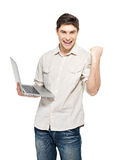 Portrait of young man with laptop  in casuals Stock Images