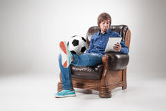 Portrait of young man with laptop and football ball Royalty Free Stock Photos