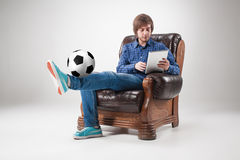 Portrait of young man with laptop and football ball Stock Image