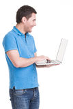 Portrait of young man with laptop. Portrait of smiling happy man with laptop in blue shirt - isolated on white. Concept communication Stock Images