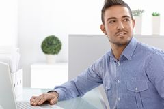 Portrait of young man with laptop Royalty Free Stock Image