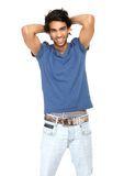 Portrait of a young man laughing with hand in hair Royalty Free Stock Photo