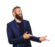Portrait of young man, laughing, pointing with fingers at something Stock Images