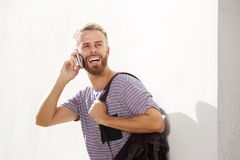 Young man laughing and talking on mobile phone. Portrait of young man laughing and talking on mobile phone Royalty Free Stock Photography