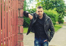 Portrait of the young man in a leather jacket Royalty Free Stock Photo