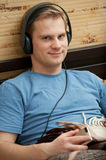 This is a portrait of a young man listening Stock Image