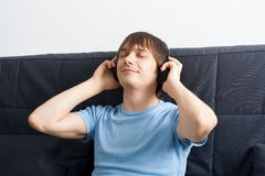 Portrait of a young man listening to music royalty free stock photography