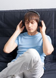 Portrait of a young man listening to music Stock Images