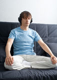 Portrait of a young man listening to music stock photography