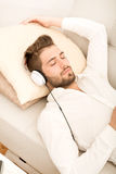 Portrait of young man listening to music Stock Image