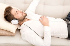 Portrait of young man listening to music Royalty Free Stock Photography