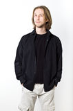 Portrait of young man with long blond hair, black shirt, white b Stock Photography