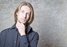Portrait of young man with long blond hair Royalty Free Stock Image