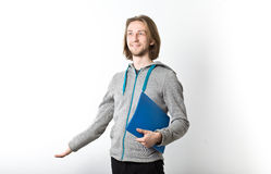Portrait of young man with long blond hair on a white background Stock Photography