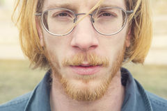 Portrait of young man with long red hair Stock Photos
