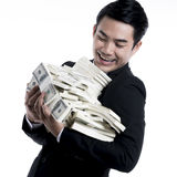 Portrait the young man looks happy with a large pile of banknote Stock Image