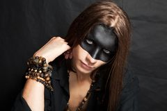 Portrait of the young man with makeup black mask Royalty Free Stock Image