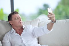 Man making self photo with his mobile phone stock photo
