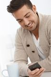 Portrait of young man with mobile phone. Portrait of young man using mobilephone, smiling Royalty Free Stock Photo