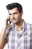 Portrait of young man on mobilephone Stock Photography