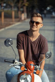 Portrait of Young Man on Motorbike Royalty Free Stock Photos