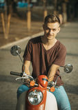 Portrait of Young Man on Motorbike Stock Photography