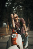 Portrait of Young Man on Motorbike Royalty Free Stock Images