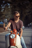 Portrait of Young Man on Motorbike Royalty Free Stock Photo