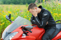Portrait young man motorcyclist royalty free stock photo
